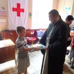 Штаб помощи переселенцам из Донбасса посетил благочинный города Мелитополя (01.09.2015)